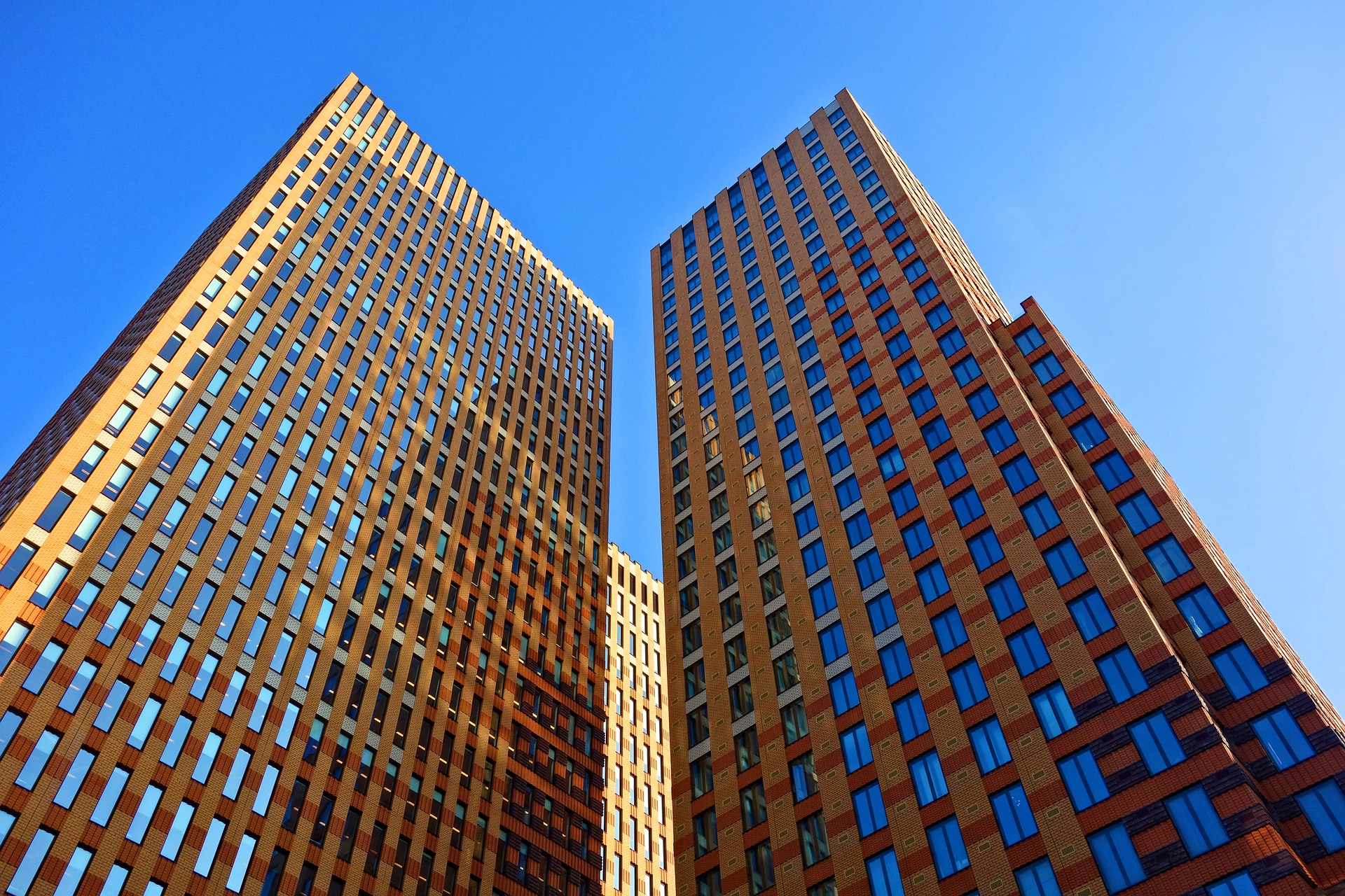 Two office tower buildings in brick and glass for plumbing and gas services for business or building owners on the One Stop Plumbing commercial Plumbing page