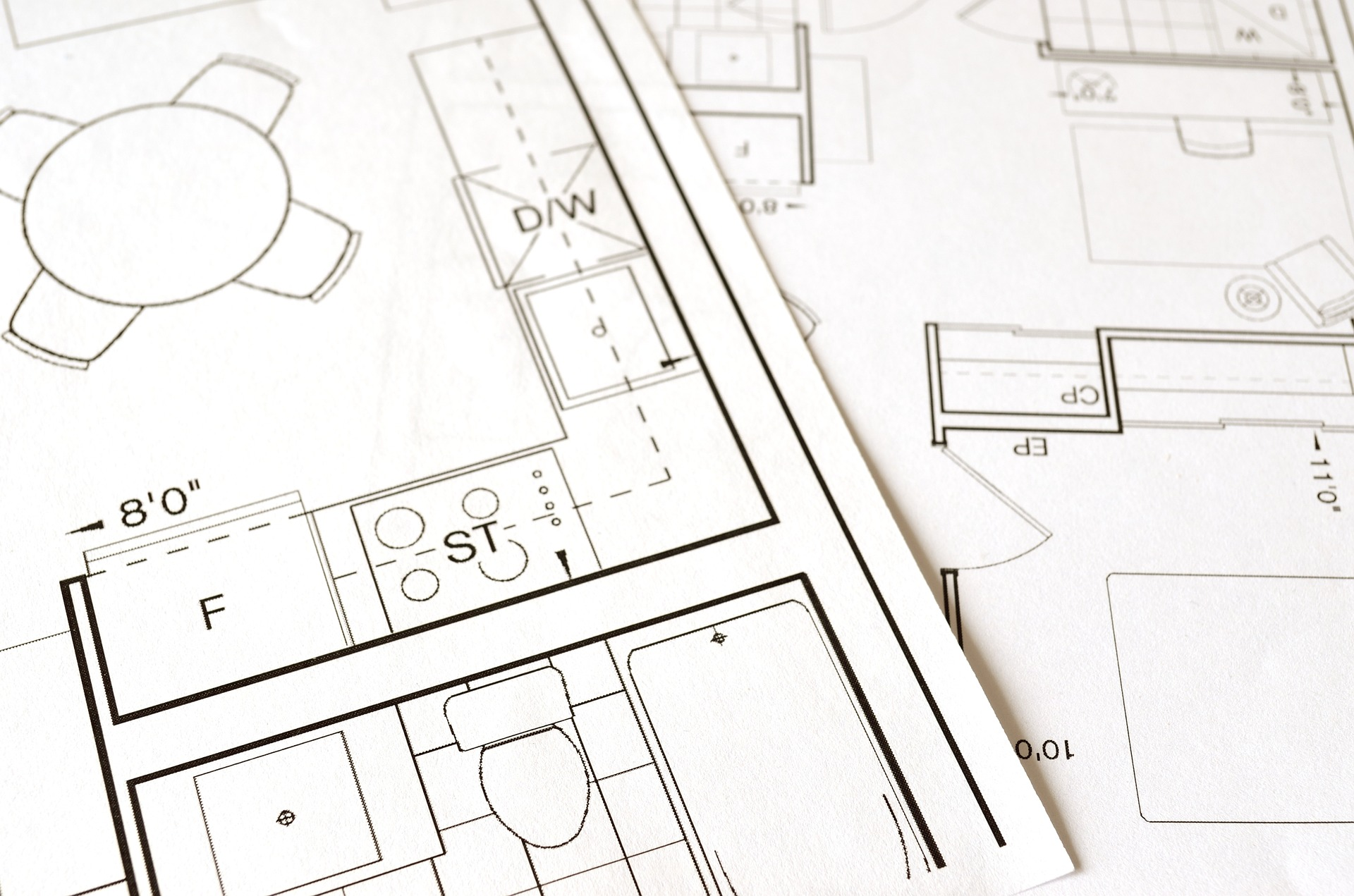Black and white architectural floor plans showing a kitchen and bathroom on the One Stop Plumbing page for Plumbing Remodeling