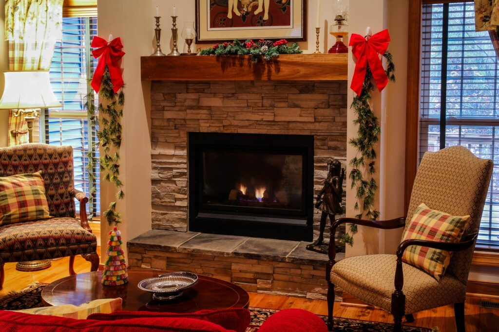 A brick gas fireplace in a living room decorated for Christmas on the One Stop Plumbing gas appliances page