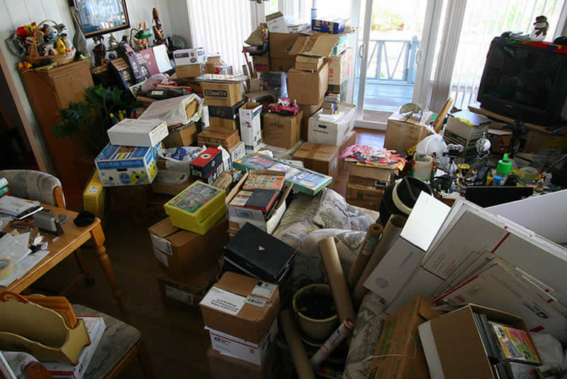 Image of super messy home that needs to be decluttered. Decluttering your home maximizes your sale price.