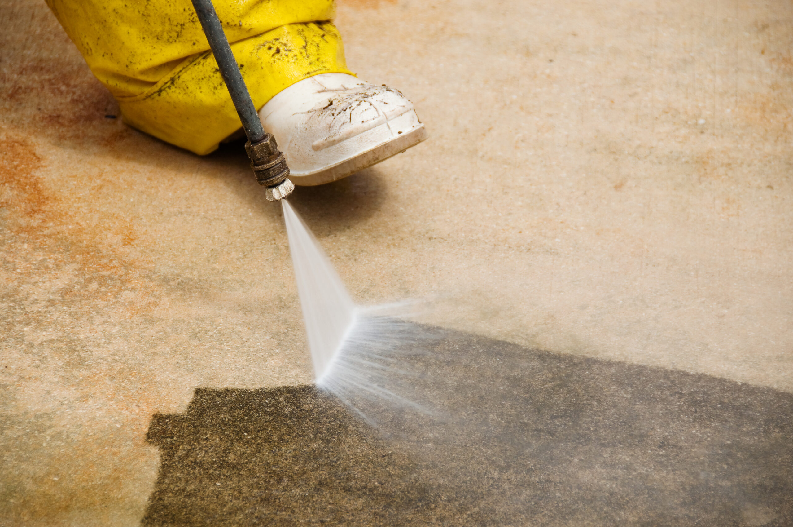 Man power washing business concrete