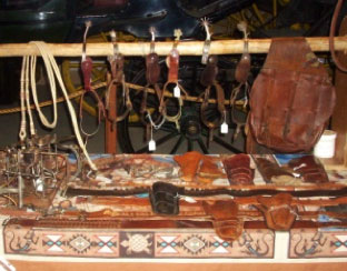 Display of leather goods including holsters and saddle bag