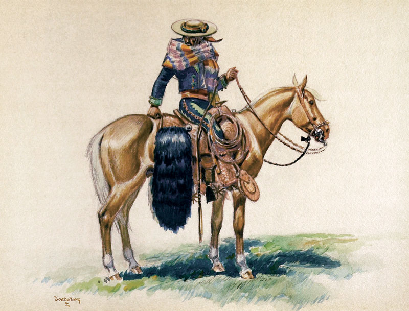 a vaquero with his grizzly bear saddle bags astride a palomino