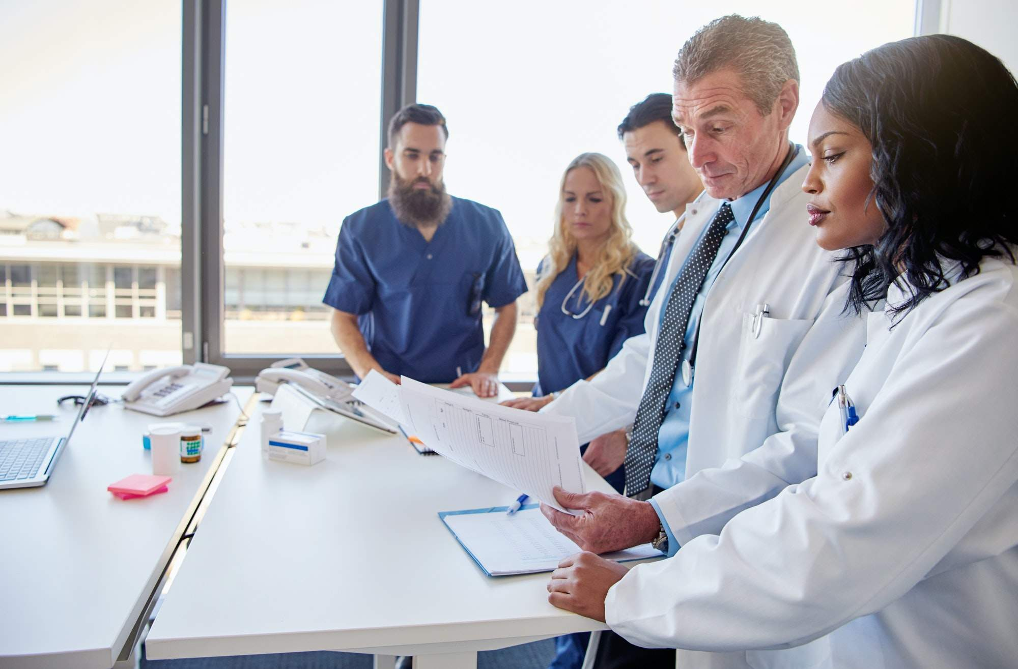 The doctors making diagnosis during the meeting