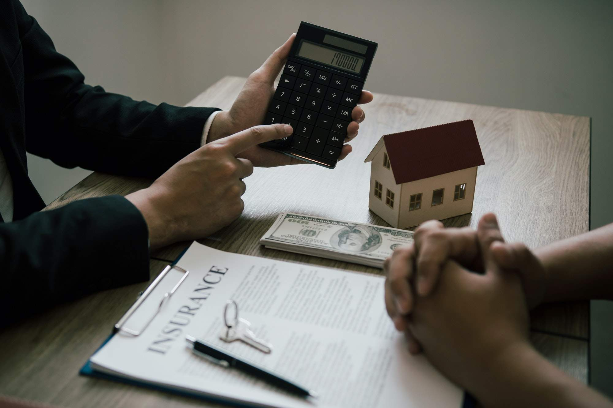 Agents are calculating the loan payment rate or the amount of insurance premiums for customers