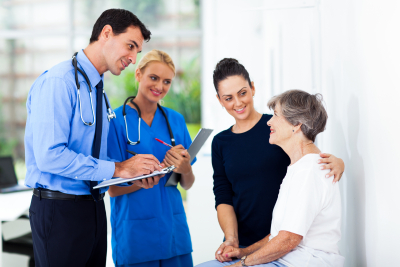 doctor and nurse talking to the senior woman
