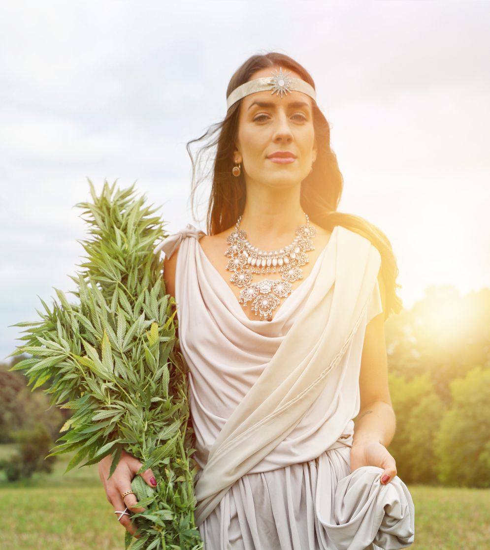 Woman holding cannabis plant