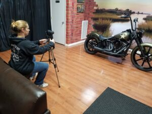 Photo of Carla photographing a motorcycle.