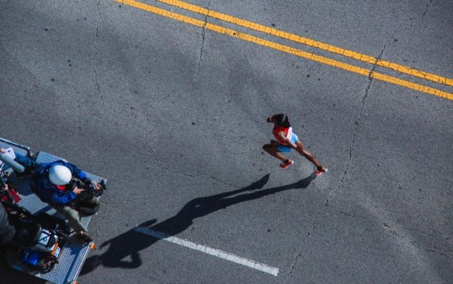 A person running during athletics. Photo by: unsplash.com