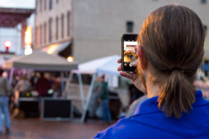 Luke Oliver taking a photo of the Davinci Stage at Carbondale Rocks Revival 2016 in downtown Carbondale, Illinois. Photo by: Matthew McGuire