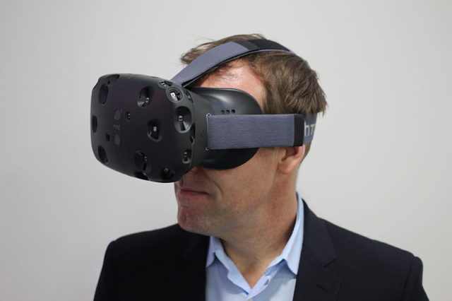 HTC executive director of marketing, Jeff Gattis wears the HTC Vive. Photo by: Maurizio Pesce / Wikimedia Commons