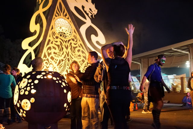 A gathering around wood burning installation. Photo taken at the 2017 Gem and Jam Festival. Photo by: Samantha Harvey