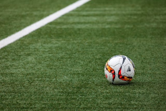 Soccer ball on field. Photo by: Pexels.com