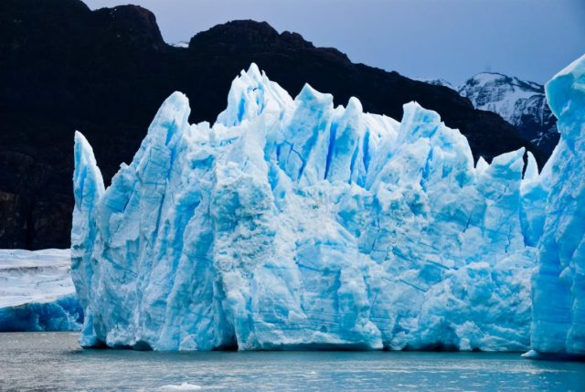 An iceberg in water. Photo by: Pexels.com