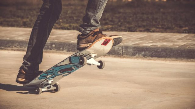 A skateboard rolling down the road. Photo by: Pexels.com