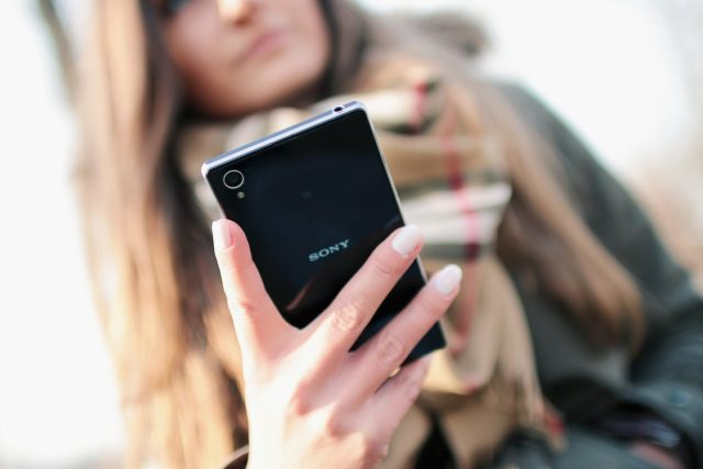 A person interacting with a Sony smartphone. Photo by: JÉSHOOTS / Pexels.com
