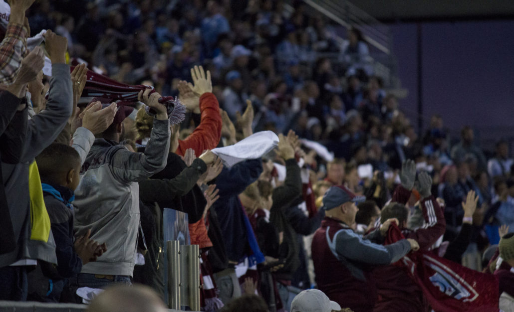 Colorado Rapids fans celebrate after the first goal of the game. Photo by: Matthew McGuire on 03/24/18 at Dick's Sporting Goods Park