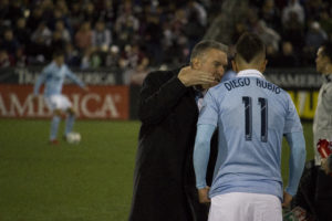 Coach Peter Vermes talks with Diego Rubio. Photo by: Matthew McGuire on 03/24/18 at Dick's Sporting Goods Park