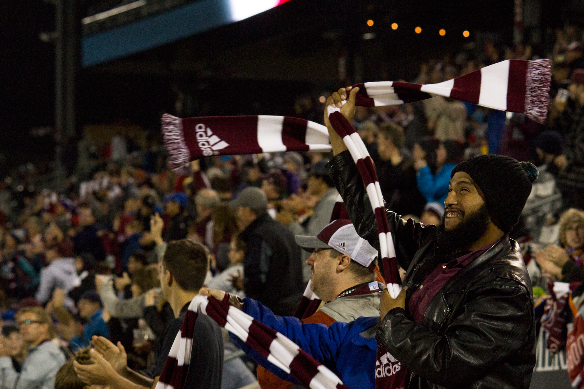 Attendees celebrate a goal in the second half at Dick's Sporting Goods Park. Photo by: Matthew McGuire
