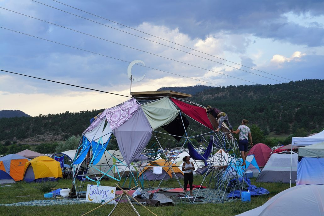 Guests create a geodesic dome and add color to the campgrounds in Loveland, Colorado. Photo by: Samantha Harvey
