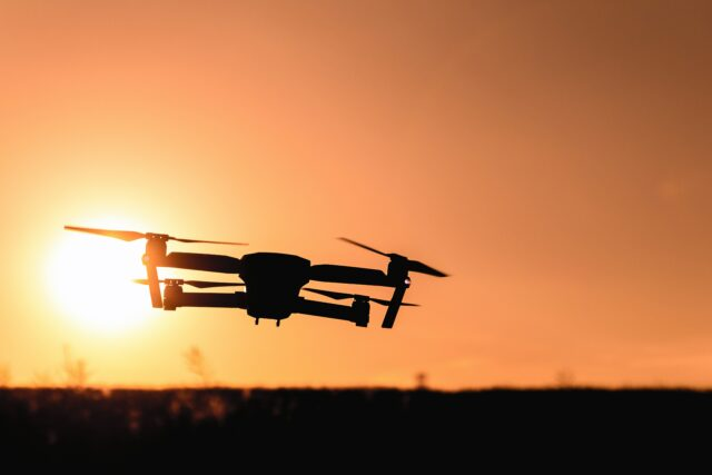 A drone flying in the sunset. Photo by JESHOOTS.com from Pexels