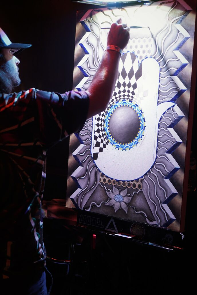 Nick Scotella painting during the Pre-Party at Cervantes' Ballroom in Denver on 01/17/20. Photo by: Samantha Harvey
