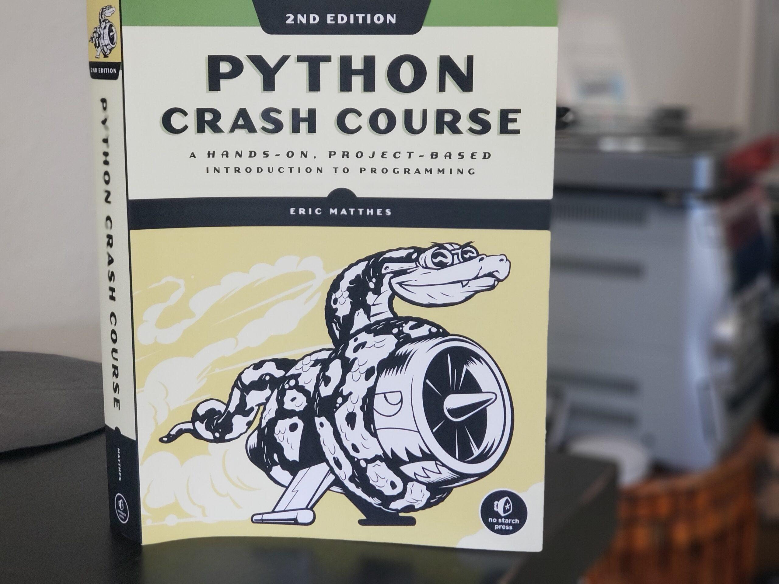 Python Crash Course book cover. Photo by: Matthew McGuire