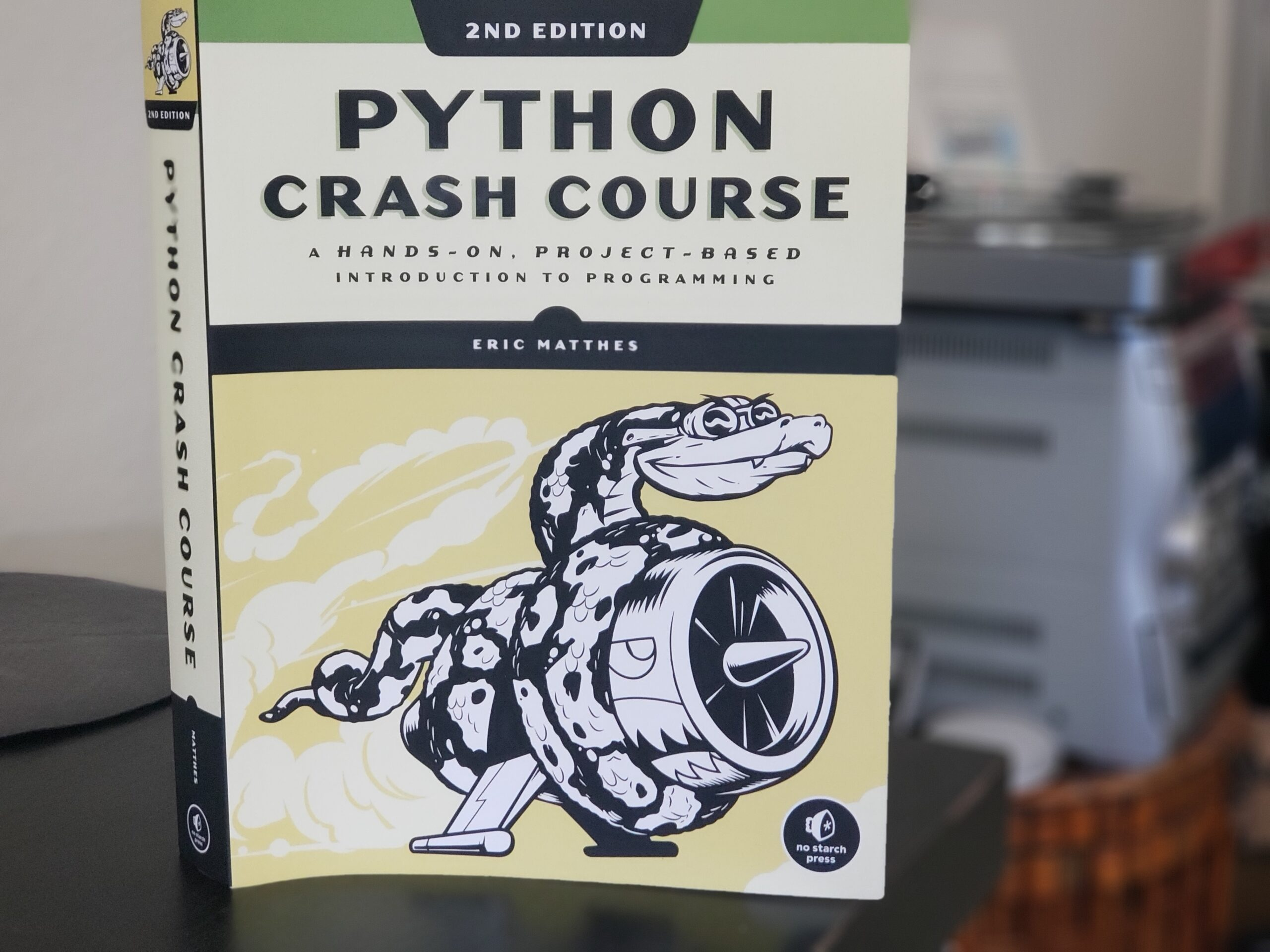 Python Crash Course book cover. Photo by: Matthew McGuire