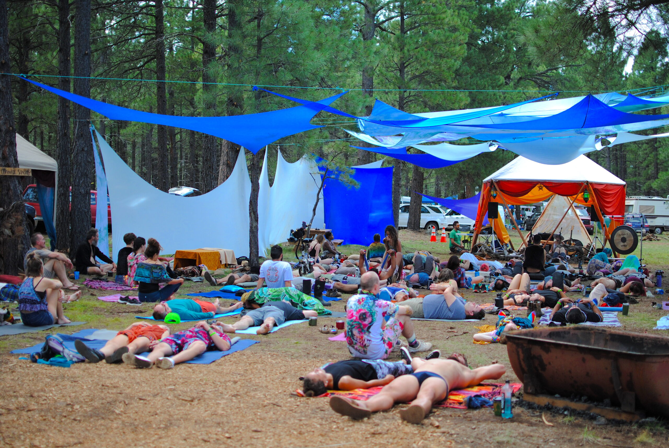 Festival goers relax and soak up the ambient Sound Bath by Rogue Reverie. Photo by: Marissa Novel.