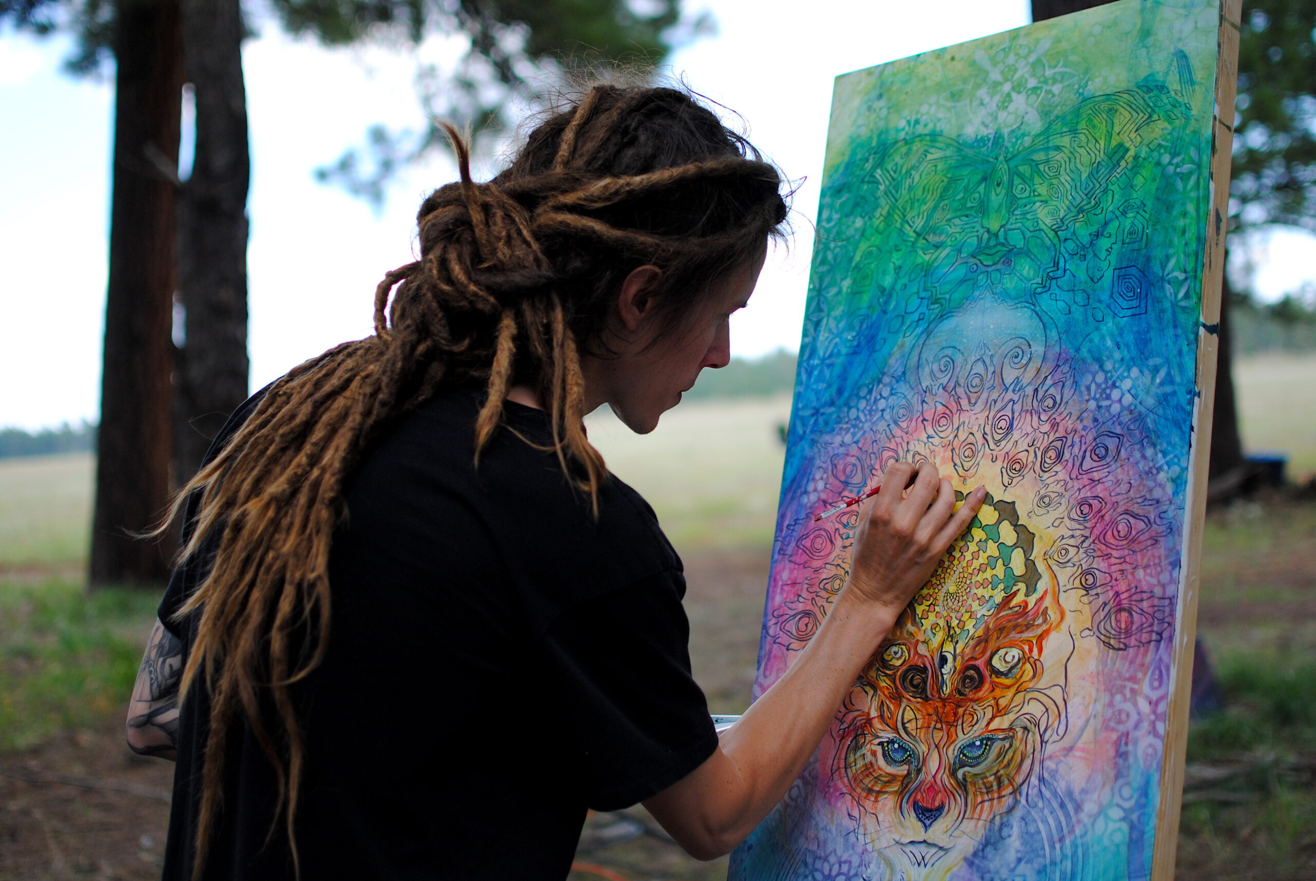 Northern California artist Bill Bishop live paints across from the main stage Saturday afternoon. Photo by: Marissa Novel.
