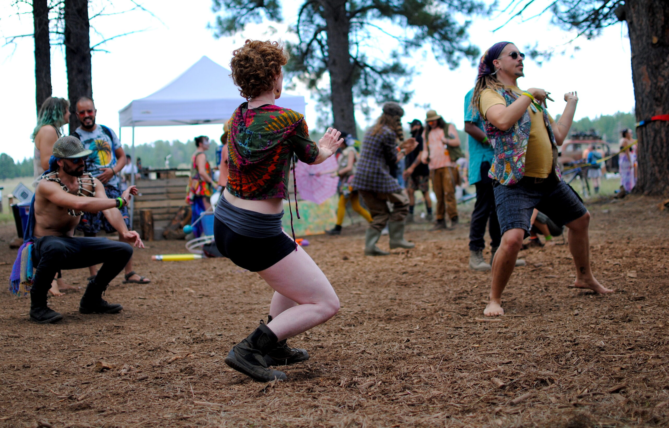 Festival-goers groove and flow among the Ponderosa Pines. Photo by: Marissa Novel.