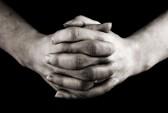 865690-female-hands-clasped-in-prayer