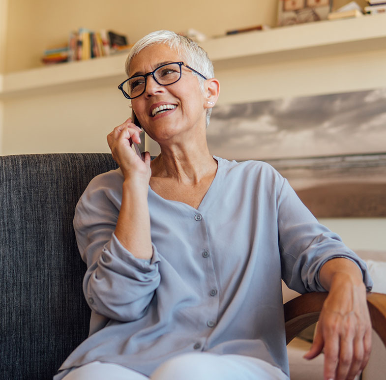 mature woman talking on phone giving out her patient information