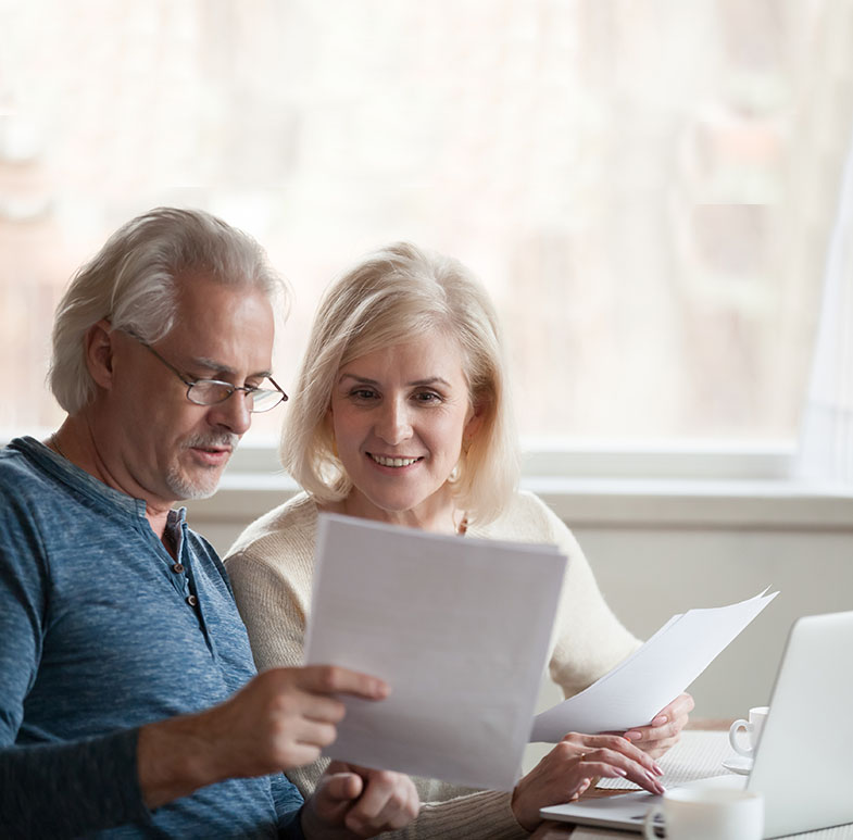 middle aged couple filling our patient info forms