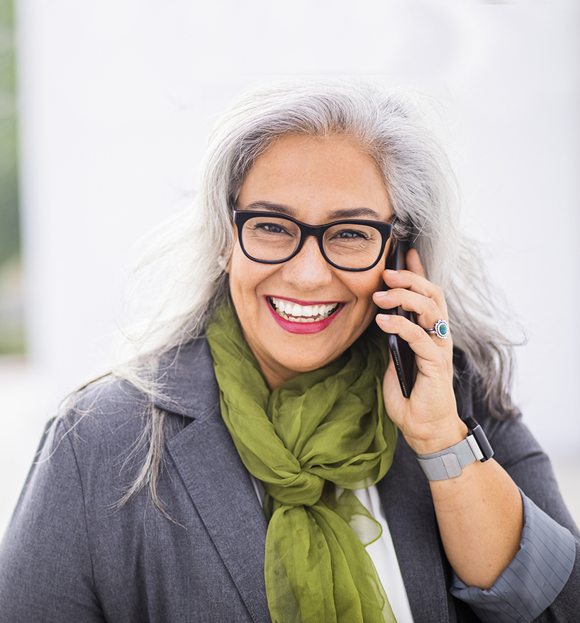 mature woman on the phone to contact Northwest Neurosurgical Associates in Portland