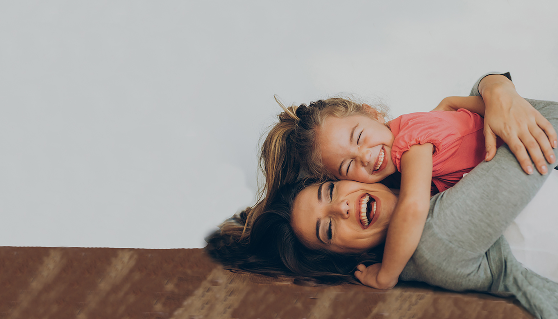 mother and daughter play on floor thanks to spine surgery with Dr. Soldevilla portland