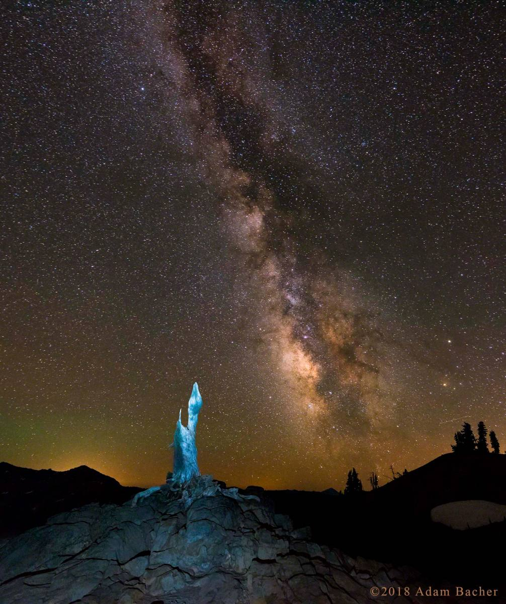 architecture of the universe: milky way night star photography,  blue light snag at crater lake national park, oregon