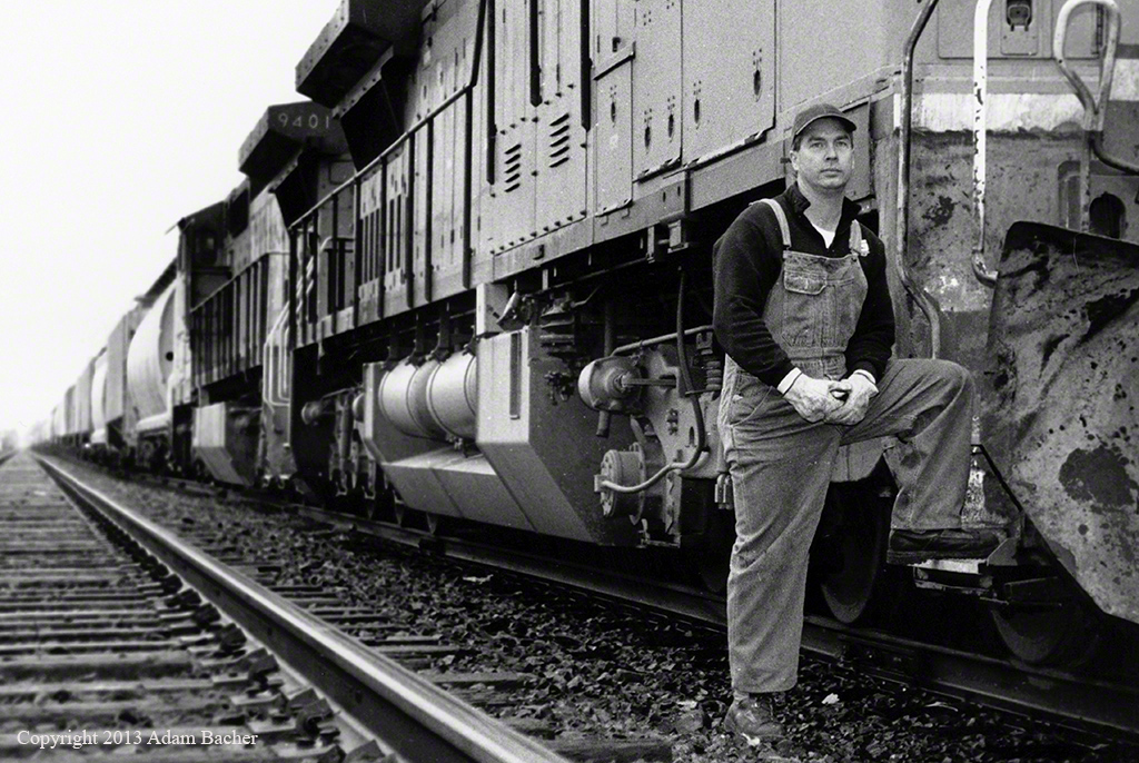 conductor and train by Portland Oregon editorial photographers