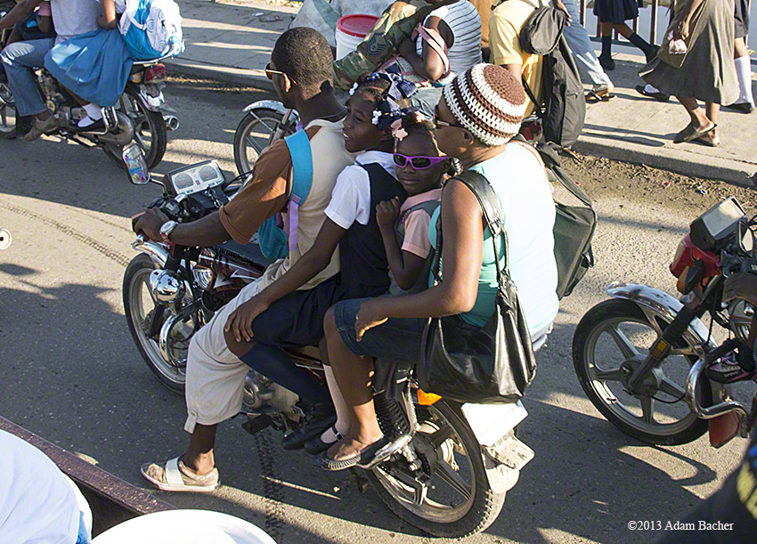 school girls on motorcycle in Haiti