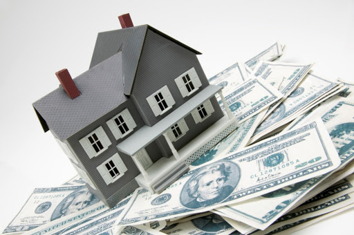 House on pile of money