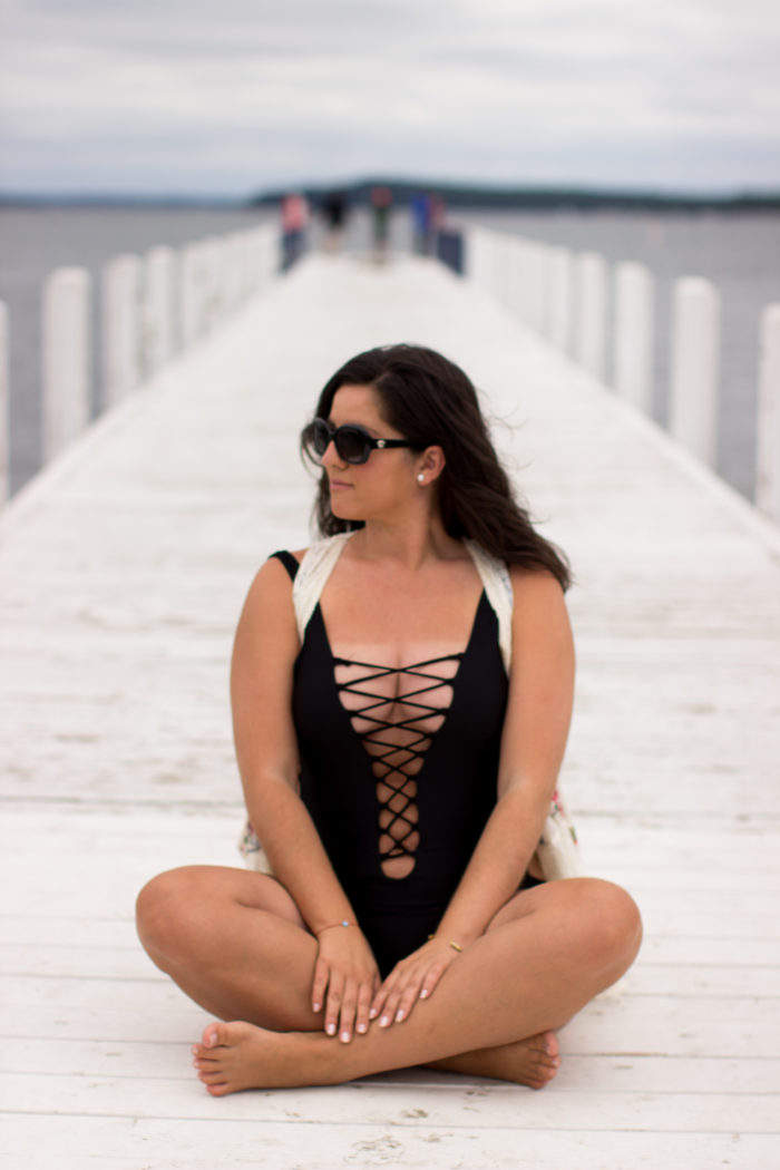 ami clubwear swimsuit review, black one piece swimsuit, crisscross swimsuit, womens swimwear, beach look, fun swimwear, stylish swimwear