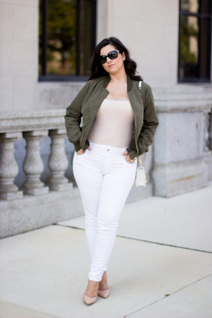 kim kardashian bomber jacket outfit, green bomber jacket, white jeans, beige pointed pumps, kim kardashian style, kim kardashian fashion, kim kardashian outfits