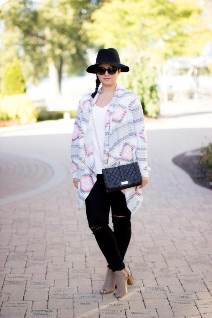 black jeans, printed cardigan, open toe suede booties, pop sugar hat, quilted crossbody, fall outfit idea. how to style black jeans