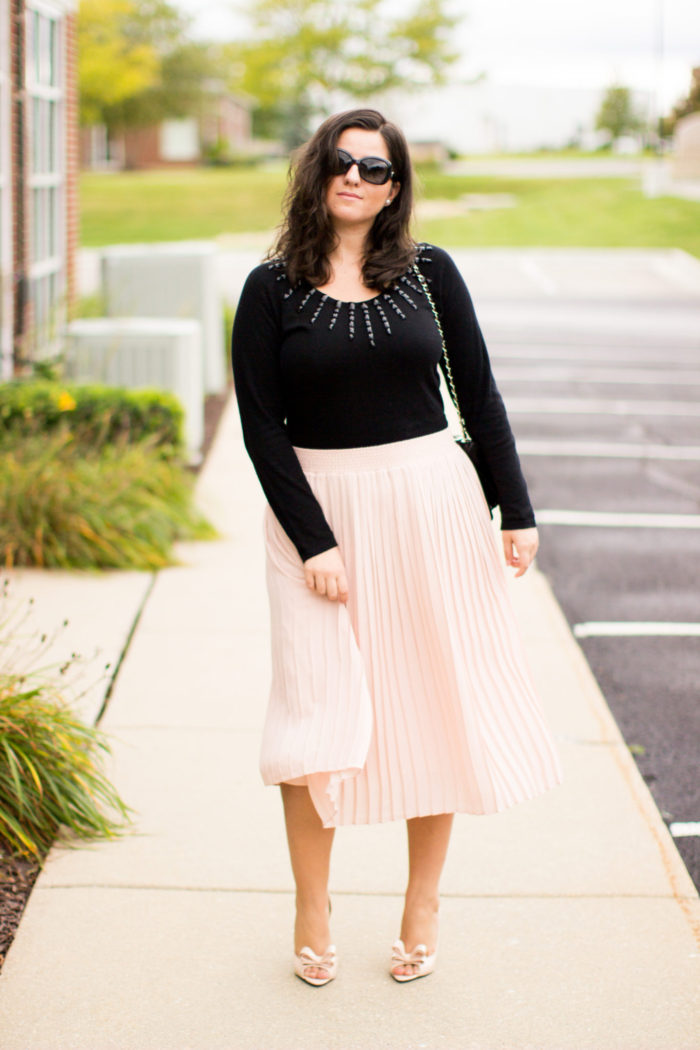 pink and black combination, pink midi skirt, black sweater, embellished sweater, bow pumps, girly fall outfit, work outfit idea,