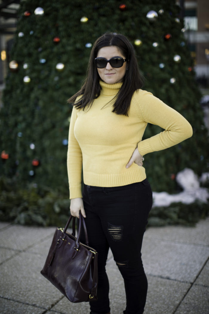 casual winter outfit with a yellow sweater, mustered yellow turtle neck sweater, black ripped jeans, black distressed skinny jeans, CAT wedge booties, ralph lauren satchel