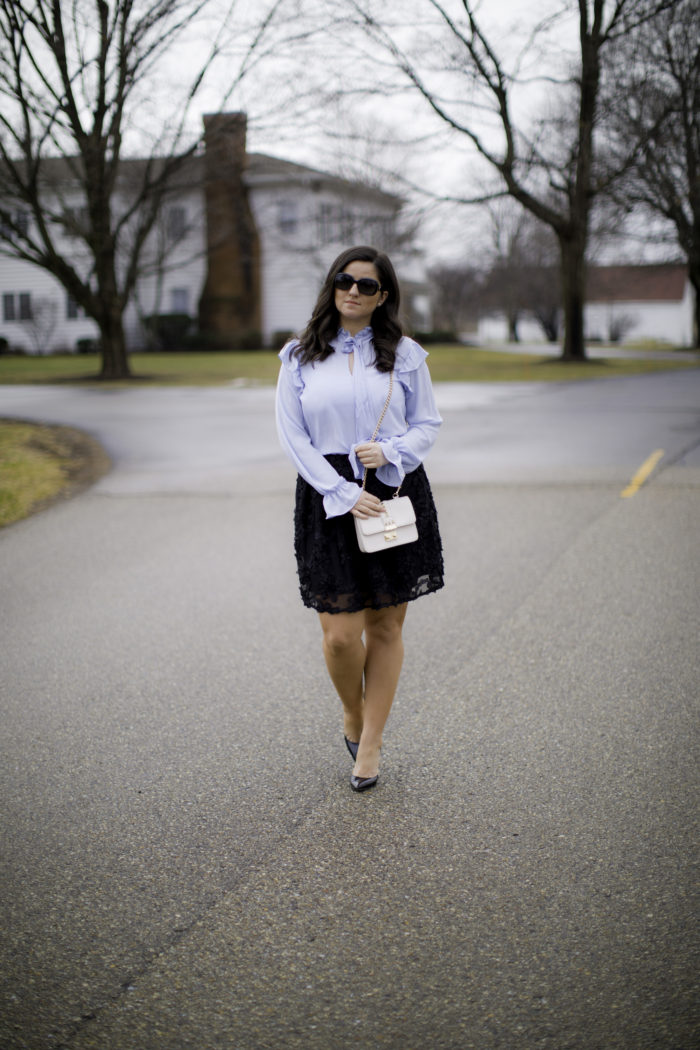 how to style a pussybow blouse, light blue blouse, black flower mini skirt, black pumps