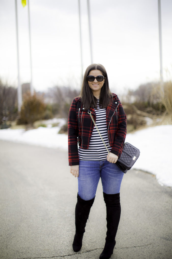 buffalo print jacket, striped top, quilted crossbody, black boots, winter outfit idea