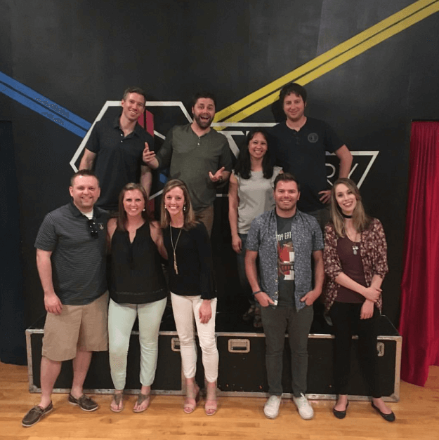 Escape Room Team Poses In Escape Artistry Lobby