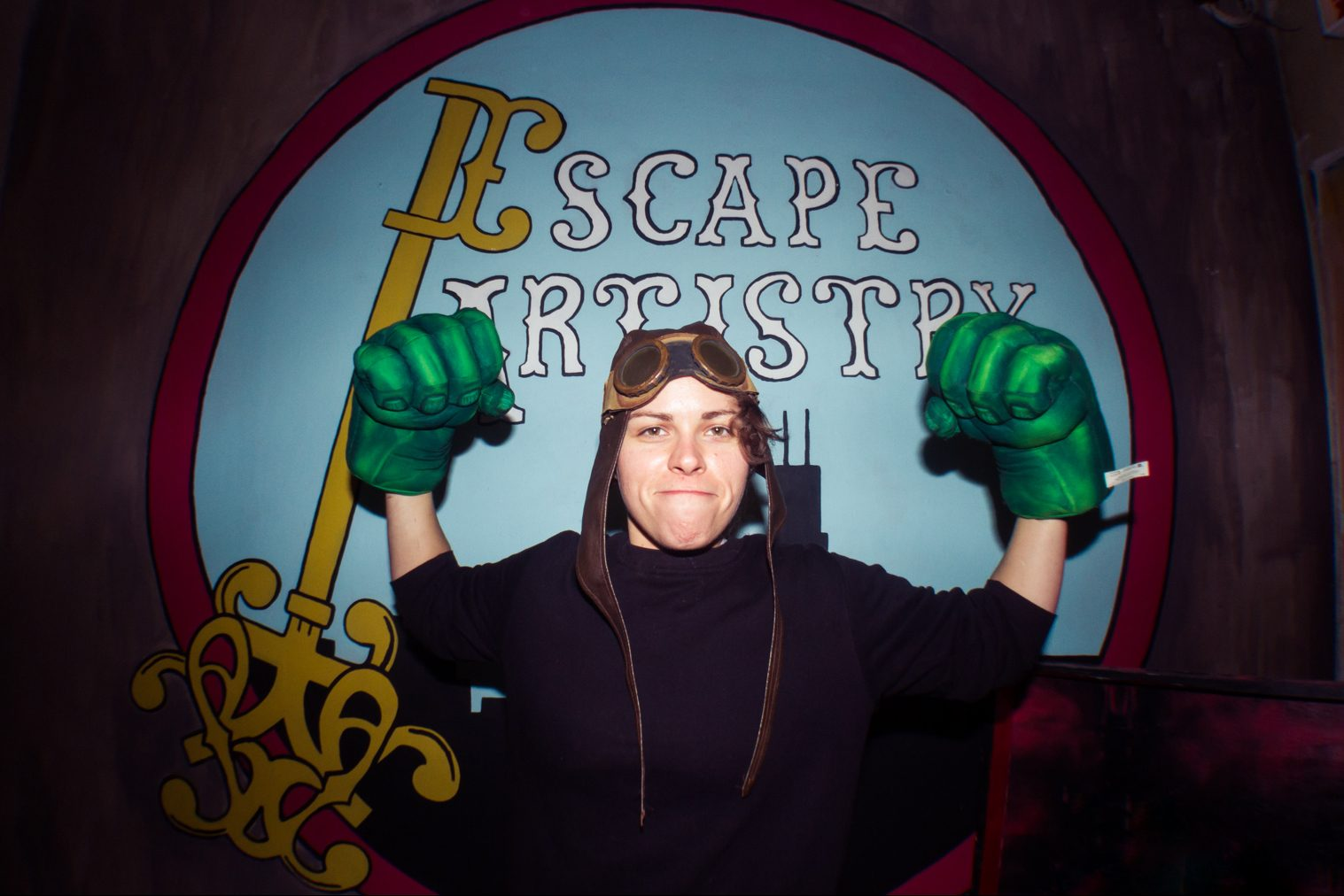 Woman Flexing Muscles With Hulk Gloves On