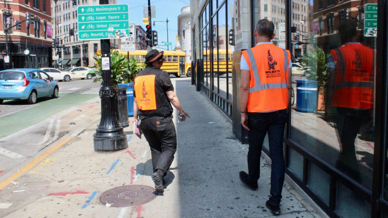 Two Wicker Park Ambassadors In Orange Vests Scout The Sidewalk